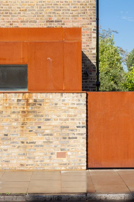 This oxidised-steel extension to an end-of-terrace Victorian house in east…