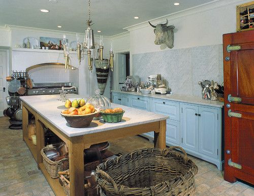 This kitchen is slammin'!   Use an open-bottom utility table for the kitchen island and top it with classic Carrara marble. Then opt for a slab of Carrara for an extra-tall backsplash. To make this look work, leave room in the budget for chunky baskets.