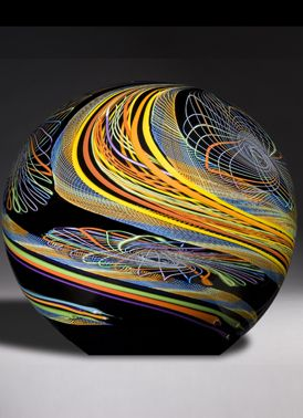 ROLLIN KARG - Renowned glass artisan from the Midwest who designs and creates small and massive sculptural pieces from molten glass, usually shaped in a freeform, asymmetrical manner. He brings the glass to life through his dynamic use of colour, especially dichroic colours – a colour that transmits one colour while reflecting another – which adds a unique dimension to the piece.