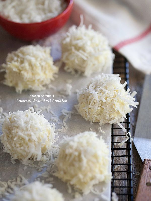 Coconut Snowball Cookies dipped in white chocolate and dunked in coconut. All my favorite flavors!