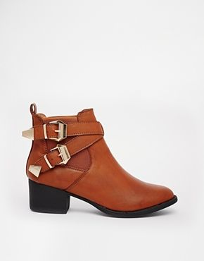 Shop Truffle Jet Buckle Strap Ankle Boots at ASOS.