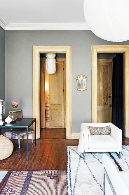 The Most Sophisticated Studio Apartment You've Ever Seen// oak door frames, layered rugs, paper lanternsStudio Apartments, Paper Lanterns, Oak Doors, Grey Wall, Layered Rugs, Doors Frames, Studios Apartments, Sophisticated Studios, Gray Wall