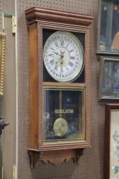 "Price guide for Gilbert oak regulator wall clock, 37"" h."