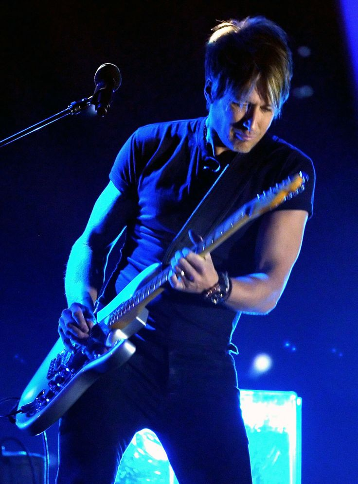 Keith Urban performs onstage during the Grammy Nominations Concert at Nokia Theatre L.A. Live on December 6, 2013 in Los Angeles, California.