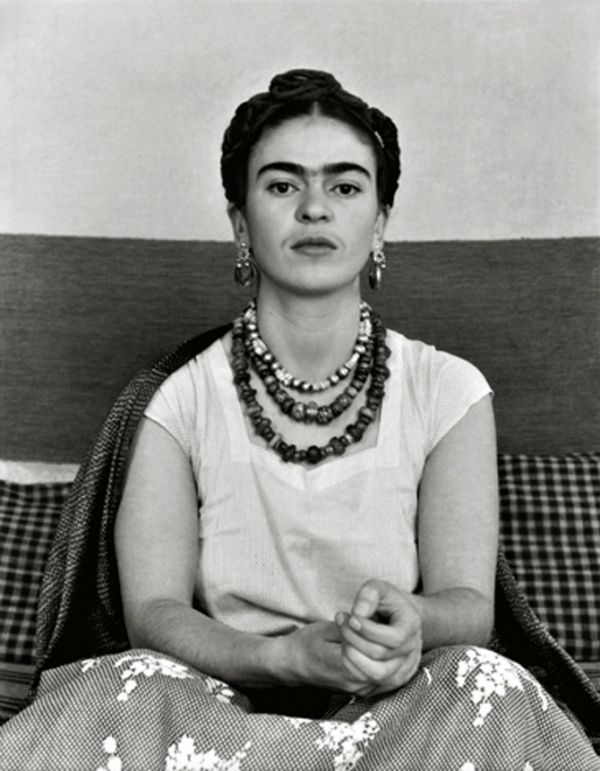 Frida Kahlo - white t-shirt, patterned skirt, big necklaces. Such a strong, awesome look.