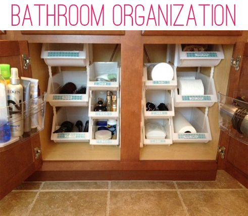 So much wasted space in those giant cabinets. I need to do this. (I got some stacking baskets and drawer organizers at Target and essentially did this under my sink.  I love how easy everything is to find now. - K)
