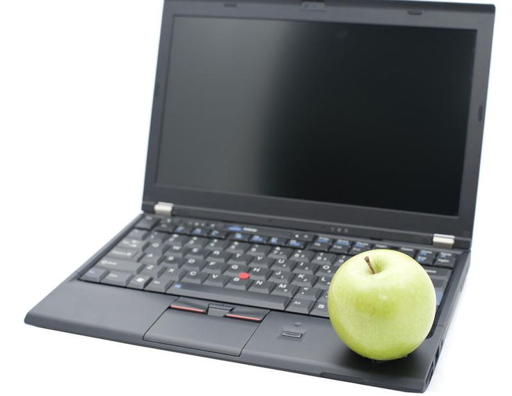 Free Stock Photo: Modern education concept with a healthy green apple balanced…