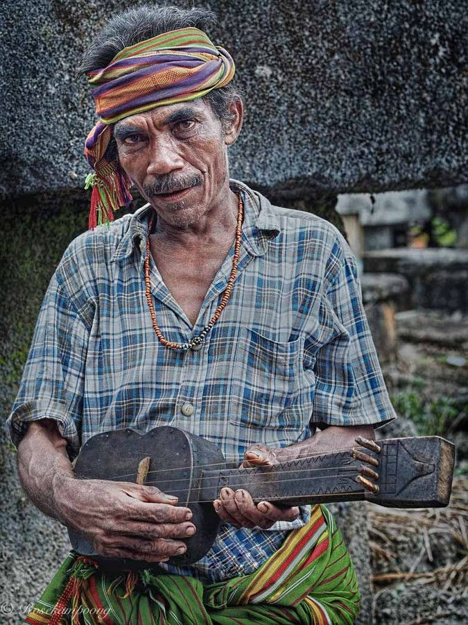 Dungga Player by Rose Kampoong on 500px. Players Dungga, Dungga a traditional stringed instruments from Southwest Sumba, a small guitar with three strings. Dungga played to accompany the poem is sung in the local language is very distinctive.