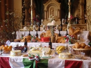 This photo depicts an altar decorated for St. Joseph's day.  An Italian custom transplanted to New Orleans, women of the parish spend weeks preparing an array of special foods.  People pay to come and eat the bounty, and the money is given to the poor.  St. Joseph is the patron saint of Sicily.