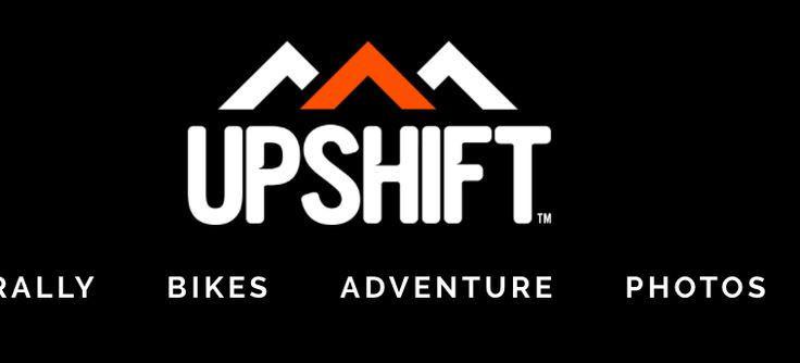 Logo for adventure motorcycle magazine Upshift. Minimal but very effective way of the three angles to represent a mountain range associated with adventure and freedom. Thsi could be adapted for cycling.
