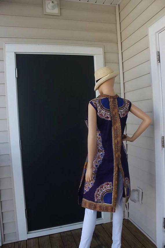 The African Dashiki Tunic Blouse is a dressed up trench for any occasion Details - All measurements are in inches * Note - On custom Request - Prices may vary on bigger sizes. Outfit: Blue and orange collar sleeveless dashiki Fabric Content Shell: 100% cotton Lining/color - 100% cotton