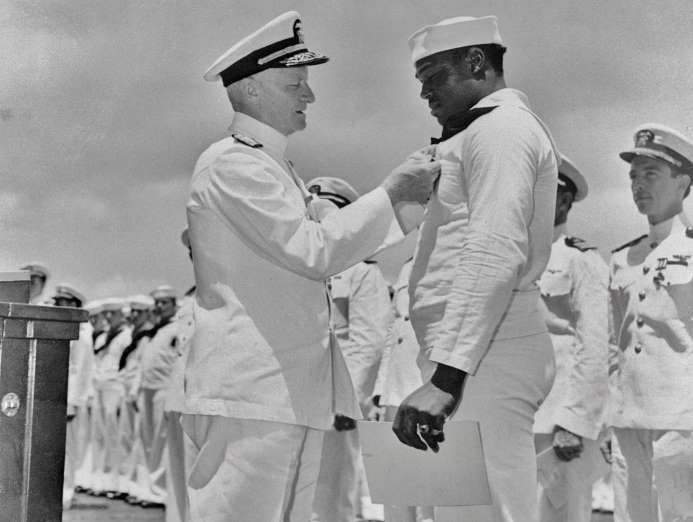 """May 27,  1942: DORIS MILLER BECOMES FIRST AFRICAN-AMERICAN TO RECEIVE NAVY CROSS  -  Doris """"Dorie"""" Miller, a cook aboard the USS West Virginia, becomes the first African-American to receive the Navy Cross for displaying """"extraordinary courage and disregard for his own personal safety"""" during Japan's attack on Pearl Harbor."""