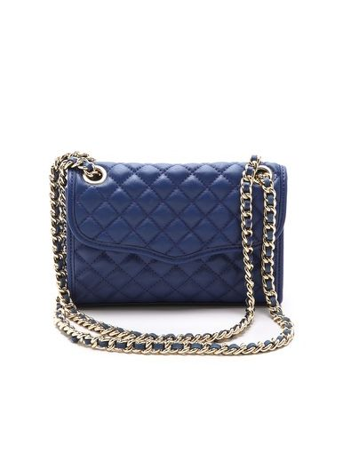 Rebecca Minkoff's handbag makes a stylish statement in electric blue.