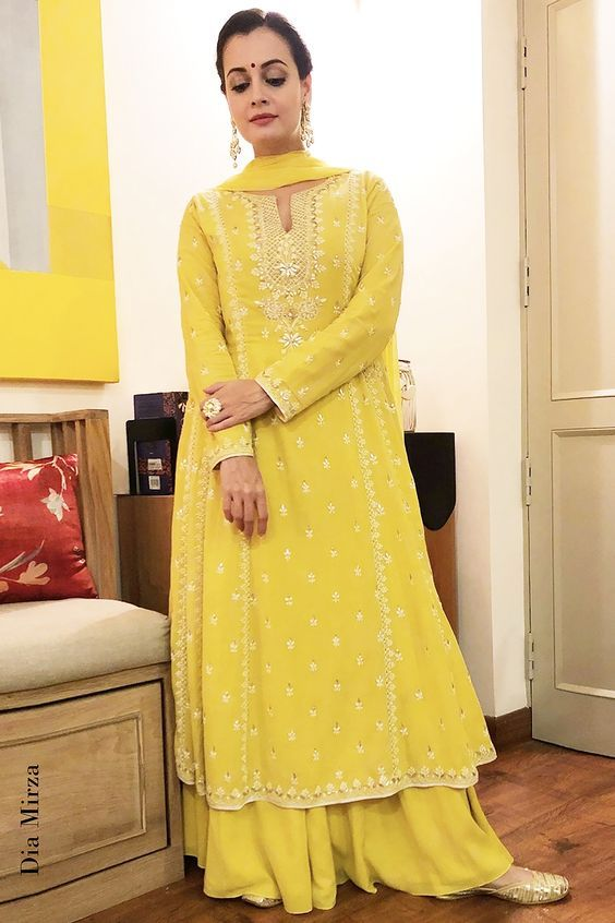 Beautiful Dia Mirza in lemon yellow kurta an plazzos | Newly wed looks inpiration | Indian brides | Indian bridal fashion | Bridal couture | Golden juttis | Newly wed indian brides | Image source: Pinterest | Every Indian bride's Fav. Wedding E-magazine to read. Here for any marriage advice you need | www.wittyvows.com shares things no one tells brides, covers real weddings, ideas, inspirations, design trends and the right vendors, candid photographers etc.