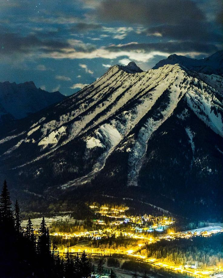 Us photo nerds spend a fair amount of time trying to find different new ways to shoot our subjects so it's was pretty exciting when we found this vantage point looking down on Mt Fernie with the moon in just the right spot.  #ferniephotographer #nightphotography #explorebc #nightlandscape #fernie