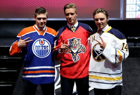 Leon Draisaitl Photos Photos - (L-R) Leon Draisaitl third overall pick by the Edmonton Oilers, Aaron Ekblad first overall pick by the Florida Panthers, and Sam Reinhart the second overall pick by the Buffalo Sabres pose during the first round of the 2014 NHL Draft at the Wells Fargo Center on June 27, 2014 in Philadelphia, Pennsylvania. - NHL Draft: Round 1