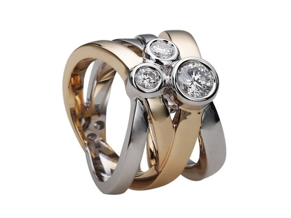 Hope to have this one day - A modern two tone custom designed ring featuring 3 round brilliant cut diamonds