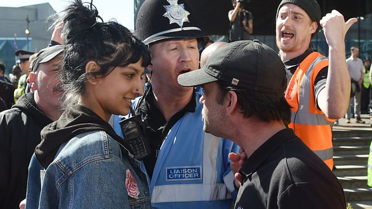 A young woman captured in a striking image at a Birmingham protest explains why she confronted an EDL leader.