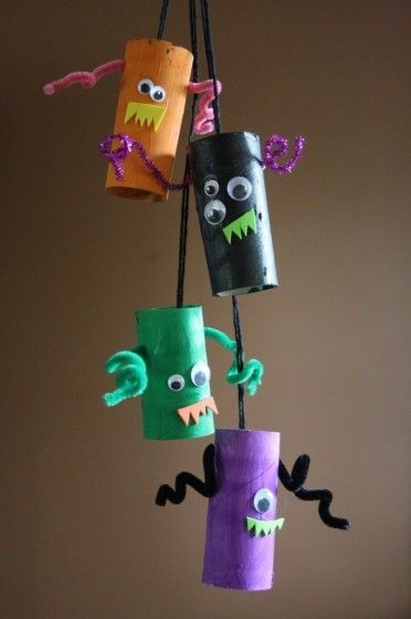 For kids who like a little less scary...easy monsters made from cardboard tubes, paint, pipe cleaners, google eyes, and foam.  monster mobile - happy hooligans - toilet roll tube monsters