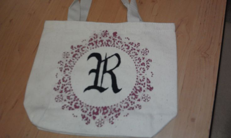 monogrammed Canvas bag. I used spray adhesive on a doily and tacked it to the bag, painted only the part i wanted, the circle, and then used a stencil to put in the letter R.