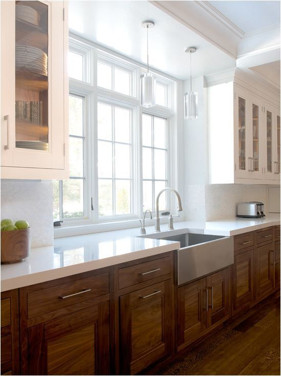 1) shaker style or flat contemporary door fronts; 2) white surfaces for contrast (backsplashes & countertops); 3) modern hardware or cutout pulls; and 4) the use of white cabinetry mixed with wood cabinets.