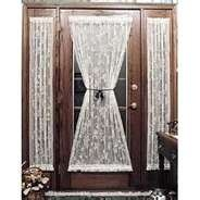 french door curtains gathered in the middle with a ribbon