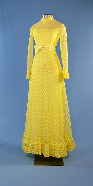 A lemon yellow, polka dot dress designed by Frankie Welch for First Lady Betty Ford. The yellow, chiffon gown features polka dot layers over a solid yellow spaghetti-strapped gown. The gown includes long sleeves with ruffles at the ends and the hem, a yellow satin ribbon around the waist, and a zipper up the back.  Mrs. Ford wore this dress on  September 12, 1974 at an event with Prime Minister Yitzhak Rabin of Israel.