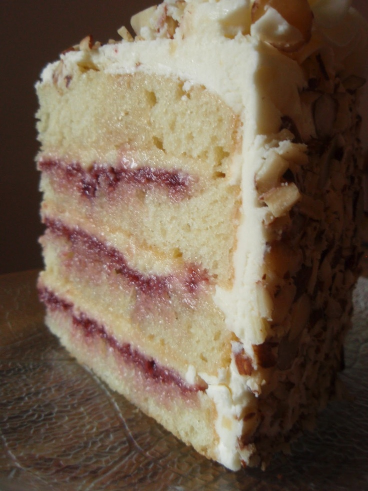 Raspberry Almond Dream Cake  Cake:  2 1/4 cups cake flour   1 tablespoon baking powder  1/2 teaspoon salt  1 1/4 cups buttermilk  4 large egg whites  1 1/2 cups sugar  8 tablespoons unsalted butter, room temperature  1/2 teaspoon vanilla extract  1/2 teaspoon almond extract