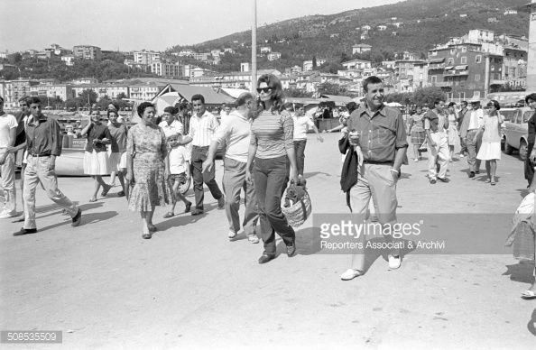 Italian actress Sophia Loren arriving in Capri with her husband, film producer Carlo Ponti, Capri, 1961.