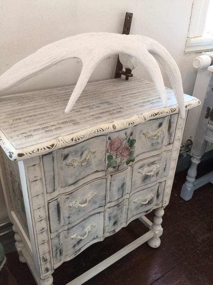 Shabby chic dresser painted white with decoupaged paper and napkin. Painted by Vintage & Färg in Sweden.