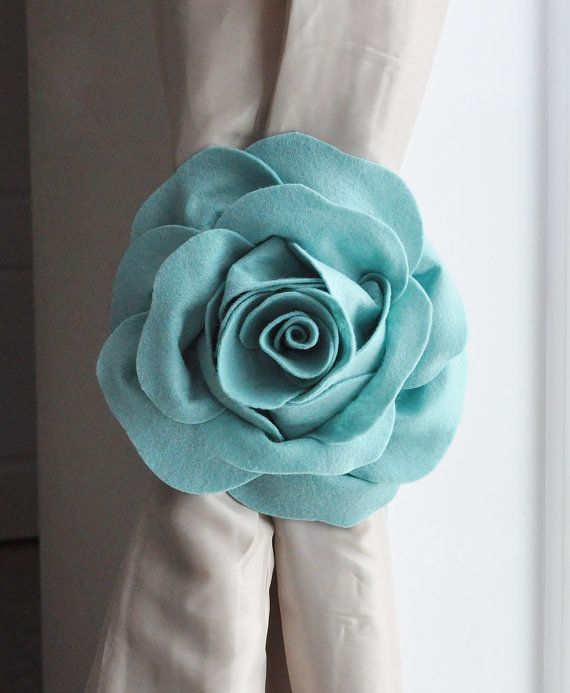 ALL ITEMS ARE MADE TO ORDER PLEASE SEE SHOP FOR CURRENT CREATION TIME!!! SET OF TWO Light Dusty Blue Rose Flower Curtain Tie Backs Tie Your Curtains Back in Style! These flowers are sure to make a statement in any room!  Perfect Finishing Touch for Any Room!  Easily hold lightweight curtains back without attaching to the wall. Or simply tie the ribbon to a screw hook or 3M Command Hook for perfect positioning. (HOOKS NOT INCLUDED)  Rose is 3D and made from High Quality Wool Felt. Flower…