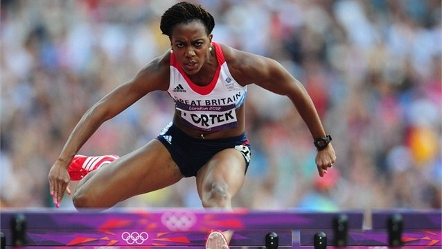 Tiffany Porter of Great Britain competes in the women's 100m Hurdles heat at the Olympic Stadium.