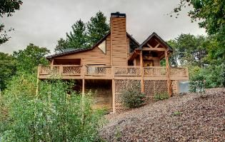 Sunset Vista Cabin - Crossrock Cabin Rentals offers many amenities including a Recreation room with a 7 foot pool table and outdoor fireplace and seating area. #BlueRidgeGa