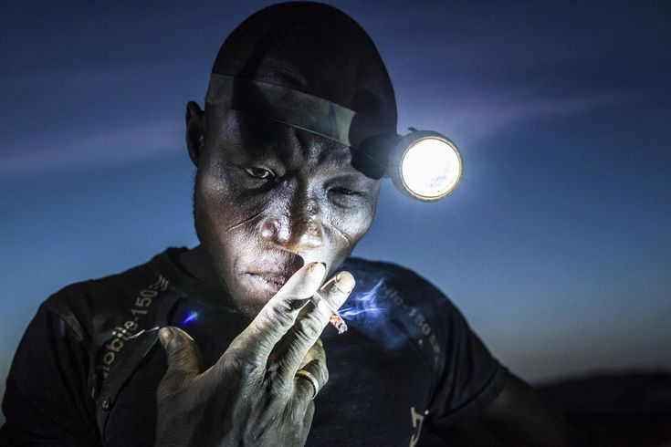 Arzuma Tinado (28) leads an eight-member crew of miners at Djuga, an artisanal gold mine in north-eastern Burkina Faso. Around 15,000 people work in the area, in pits hacked into the ground, some barely wider than a manhole. As the price of gold fell, people began to dig ever deeper to find enough to make a daily wage. Arzuma works some 20 meters underground. Mining under these conditions is backbreaking labor during which miners are constantly breathing in dust. The subsequent process of…