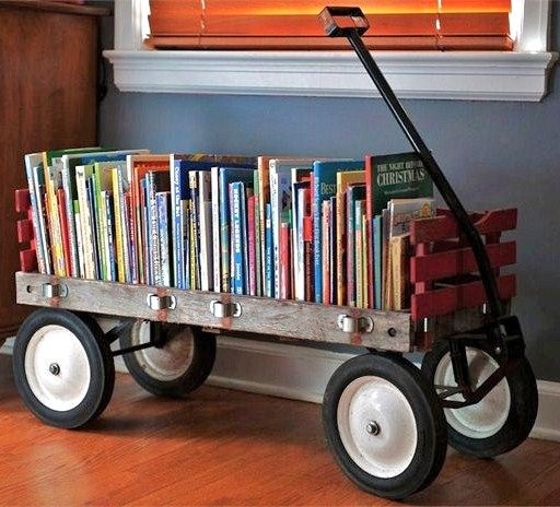 A vintage wagon to store children's books. Talk about thinking outside of the box! Ivy Clad: Guest Post: Classic Chic Home ~ ORDER IN THE PLAYROOM