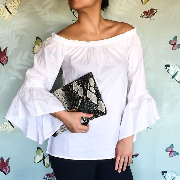 Trumpet sleeves white blouse Trumpet sleeves white blouse with elastic boat neck and box silhouette. Pair with a gorgeous skinny pants to balance the silhouette then slip into a pair of pumps for a sophisticated evening look. Shoptimist Tops Blouses