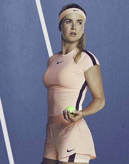 Elina Svitolina's light orange $Nike top & double shorts for Australian Open 2018