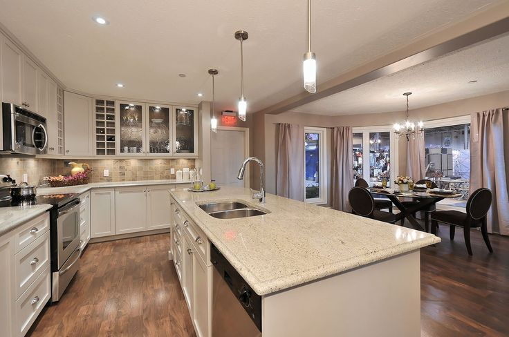 The Trent - kitchen cabinets are painted benjamin moore collingwood, kashmire white granite countertops, tile backsplash, moen faucet, custom glass cabinets with swedish walnut interior, stainless appliances, wood floors, wine racks...  www.qualityhomes.ca