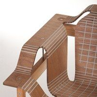 The plywood is scored and the gaps filled with flexible polymer, meaning the wood can be bent and shaped as needed