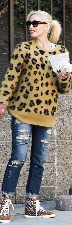 Who made  Gwen Stefani's sunglasses, leopard sweater, print sneakers, and ripped blue jeans?