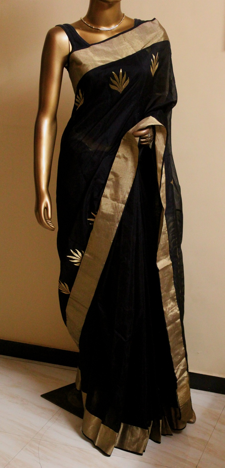 black chanderi saree maybe for attending an evening reception