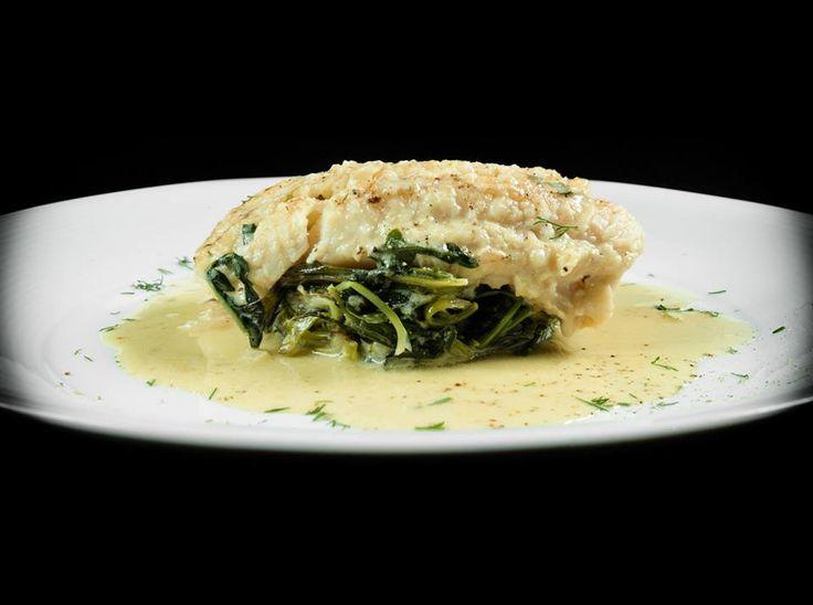 Steamed codfish with stamnagathi and fresh herbs in egg-lemon sauce. NU MODERN GREEK CUISINE CRETE PAPAROUNA WINE RESTAURANT & COCKTAIL BAR