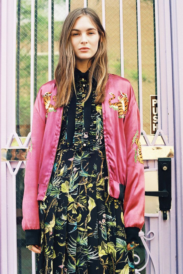 Laura Love, 24, in a vintage silk bomber jacket and Gucci tropical-print sleeveless dress