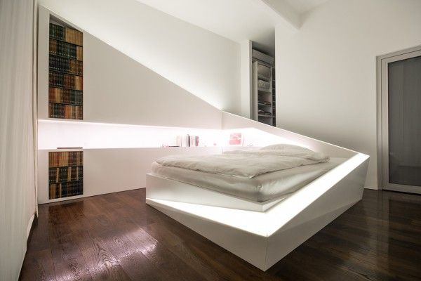 Finally, a creative options from the creatively named Who Cares?! Design. The bed in this room is known as the Ice Bed and is completely made from Dupont™ Corian. For simple lighting, an LED runs from the foot of the bed, up around to the head and built-in bookshelves lend a special element.