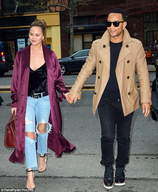 Chrissy Teigen and John Legend took a hand-in-hand stroll through Manhattan on Wednesday a...