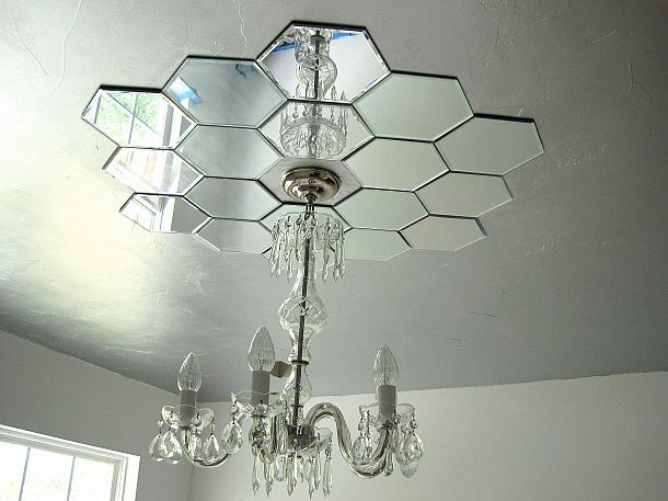 DIY: Mirrored ceiling medallion (for under thirty dollars). Or less if you use mirrored wall decals. Same idea could be used above ANY light, even the typical floor or table lamps. Just add one or two mirrored wall decals. ;)