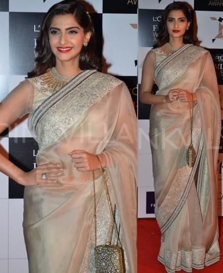 Dressed in a beige Anamika Khanna creation, Sonam Kapoor was reminiscent of a vintage painting while at the L'Oreal Paris Femina Women Awards 2014. The net blouse, red lips, side-swept hair and the beautiful clutch made for a perfect picture.