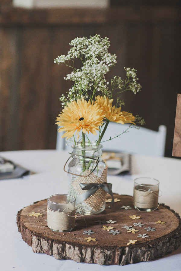 Use mason jars whenever you can. They are great for any sort of decoration, especially centerpieces. | 24 Ways To Throw A Spectacular Country-Themed Wedding