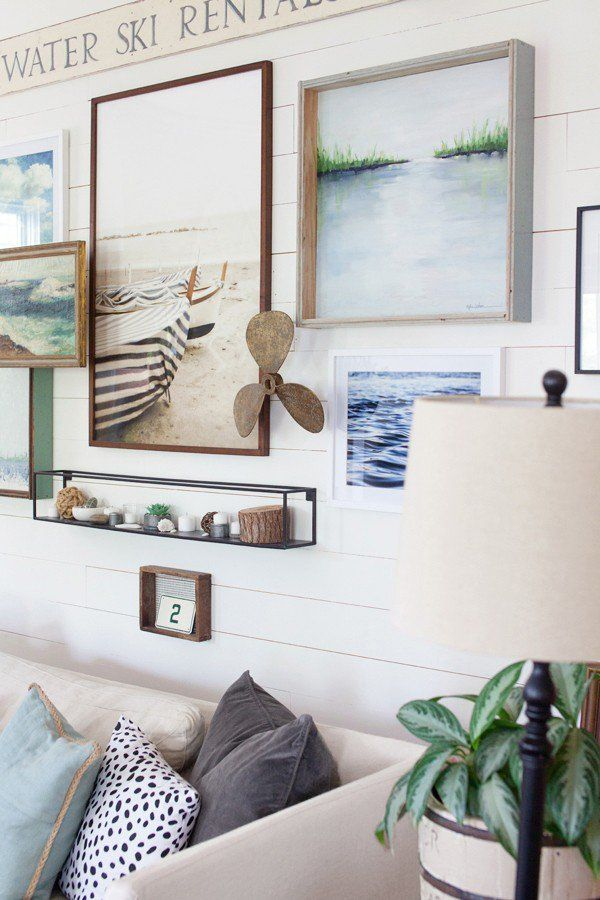 love this layered artwork wall decorating coastal cottage farmhouse