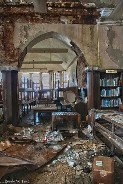 Abandoned library. It always blows my mind that the books are left and none of the beautiful woodwork isn't reclaimed.